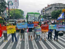 During a halt in traffic, militant youth groups occupy a pedestrian lane along España Avenue on Thursday to protest against oil price hikes. Meanwhile, jeepney drivers and supporters gathered in various parts of Metro Manila for a transport caravan. Danny Pata Source: GMA News