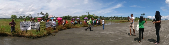 MacArthur townspeople with other civil society members and partners of Alyansa Tigil Mina hold a rally in front of an illegal black sand mining site in Maya village on August 21.