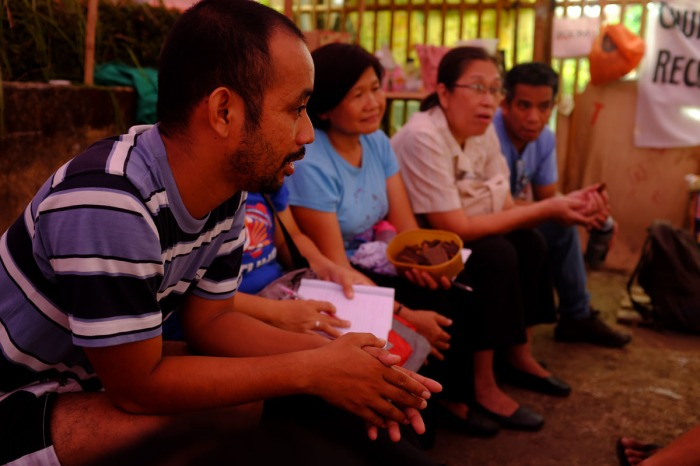 Members of the Solidarity Mission listen to the stories of Tanduay Workers. Photo from CTUHR